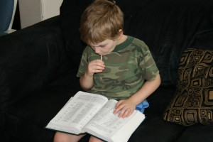 Alexander reading from Daddy's Bible