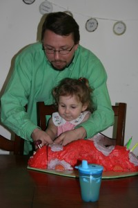 Cutting her caterpillar cake
