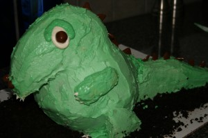 The cartoonish dinosaur cake