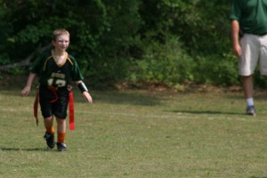 Alexander playing flag football
